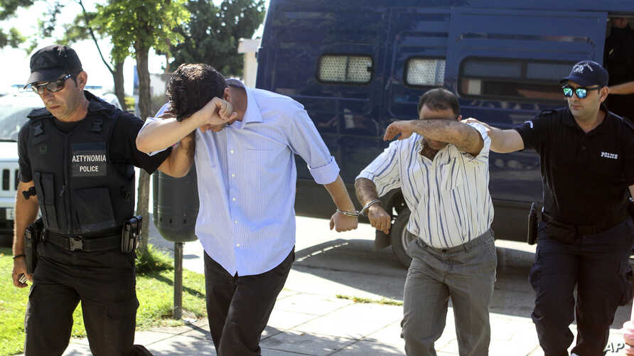 Turkish military personnel who were aboard a Blackhawk military helicopter are transferred to a prosecutor's office in the city of Alexandroupolis, northern Greece, July 17, 2016.