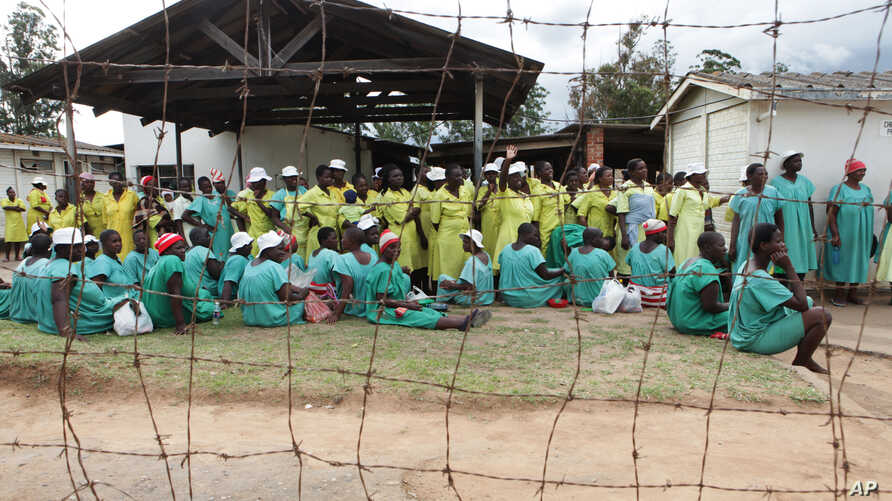 FILE - Female prisoners wait for their turn to walk out of prison following their release at Chikurubi Maximum prison on the outskirts of Harare, Feb. 17, 2014.