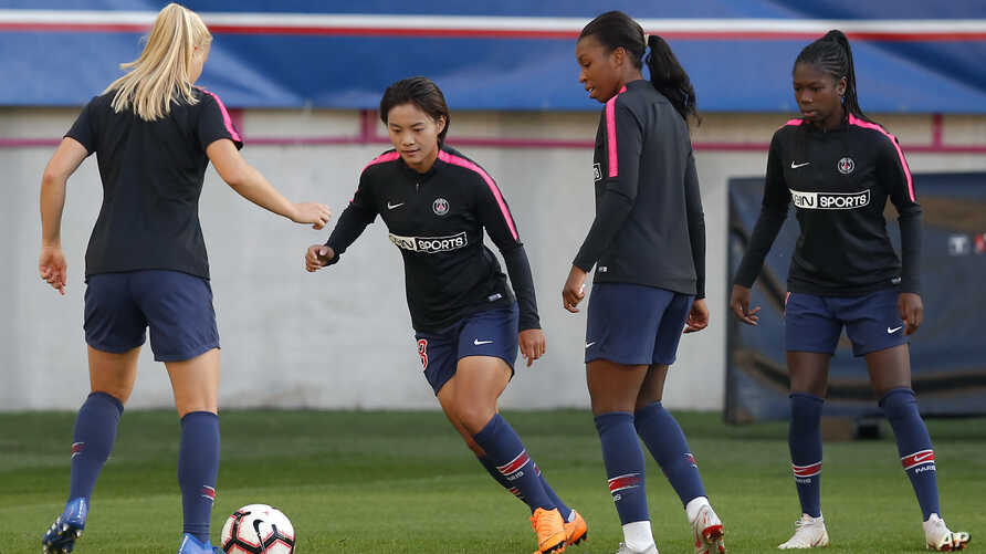 FILE - (L-R) PSG's Andrine Hegerberg, Shuang Wang, Grace Geyoro and Aminata Diallo warm up prior to their Women's Champions League soccer match between Paris-Saint-Germain and Sankt Polten at Jean Bouin stadium in Paris, France, Sept. 27, 2018.