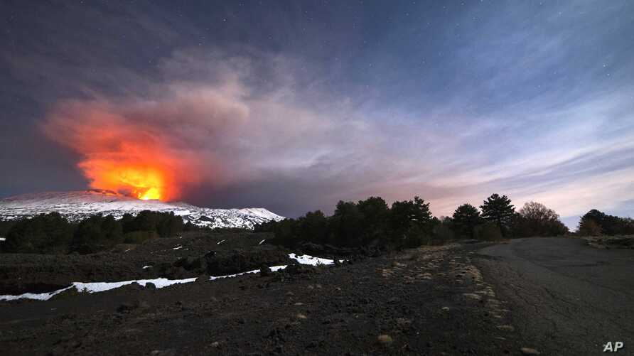 Mount Etna, Europe's most active volcano, is seen from the side of a road as it spews lava during an eruption in the early hours of Thursday, March 16, 2017.