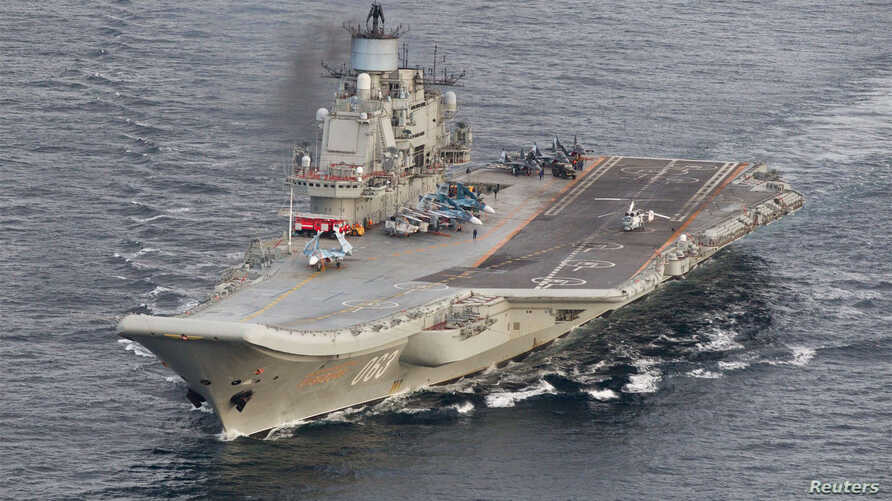 FILE -  A photo taken from a Norwegian surveillance aircraft shows Russian aircraft carrier Admiral Kuznetsov in international waters off the coast of northern Norway, Oct.17, 2016.