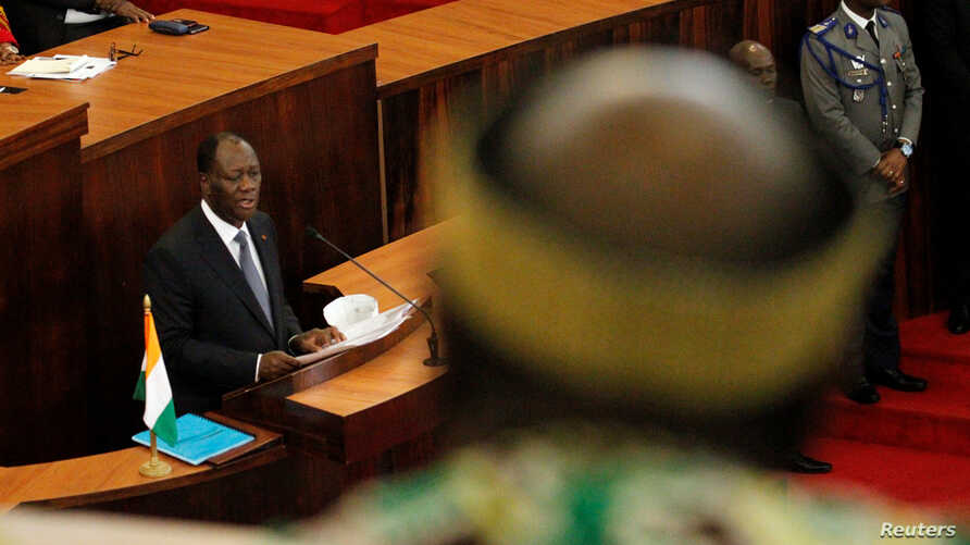 Ivory Coast's President Alassane Ouattara addresses the Ivorian parliament during the presentation of a new constitution in Abidjan October 5, 2016.