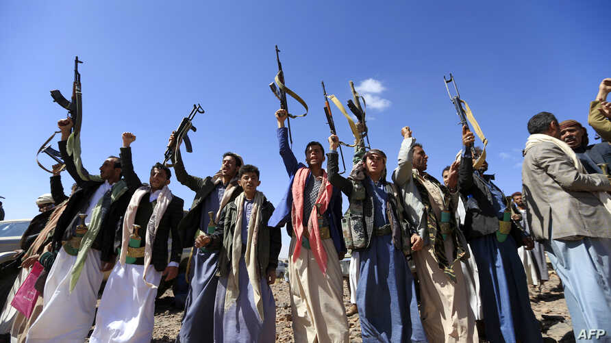 Armed Yemeni men raise their weapons as they gather near the capital Sanaa to show their support to the Shiite Houthi movement against the Saudi-led intervention, Feb. 21, 2019.