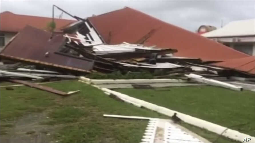 This image made from a video shows the wreckage of the parliament house that was hit by Tropical Cyclone Gita in Nuku'alofa, Tonga, Feb. 13, 2018.