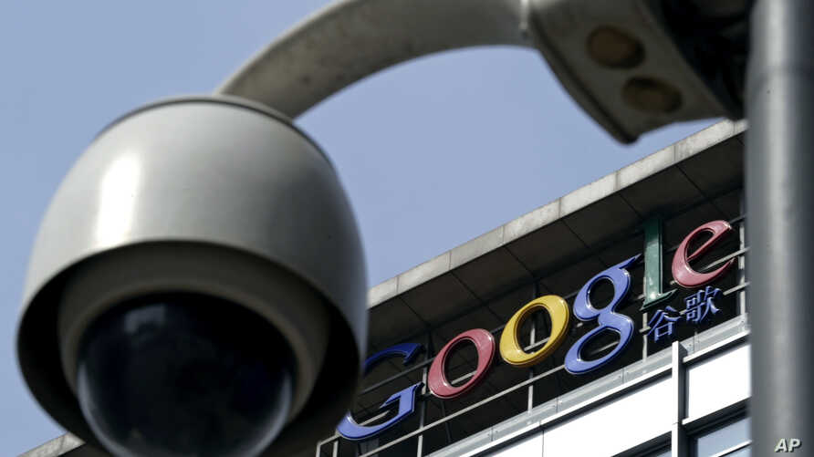 FILE -A surveillance camera is seen in front of the Google China headquarters in Beijing, China.