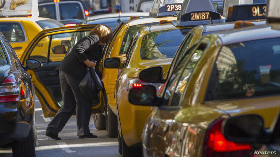 FILE - A woman exits a taxi on Third Avenue in heavy traffic caused by road closures due to high security and official motorcades during the United Nations General Assembly, in New York, Sept. 24, 2013.