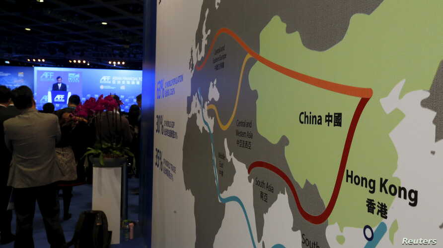 "FILE - A map illustrating China's silk road economic belt and the 21st century maritime silk road, or the so-called ""One Belt, One Road"" megaproject, is displayed at the Asian Financial Forum in Hong Kong, China, Jan. 18, 2016."