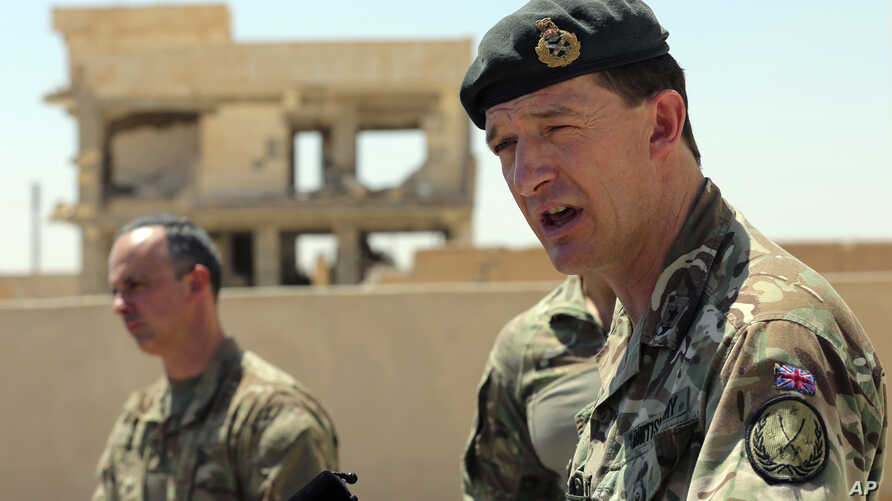 General Rupert Jones, Deputy Commanding General of the Coalition Joint Task Force, right, speaks during a press conference at the Civil Council of Raqqa, in Ain Issa, northeast Syria, July 23, 2017.