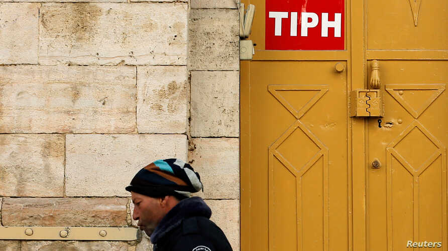 A sign of the Temporary International Presence in Hebron (TIPH) is seen on its office in Hebron, in the Israeli-occupied West Bank, Jan. 29, 2019.