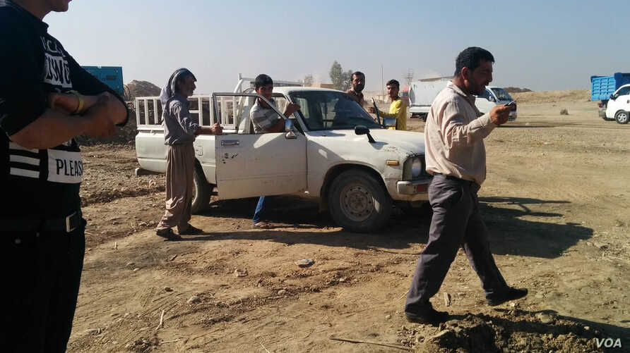 Homeowners from villages where Islamic State fighters have been driven out in recent days return to visit and gather any of their possessions that remain, despite the danger of hidden bombs in the villages, in Iraq's Kazir province, Oct. 22, 2016. (H