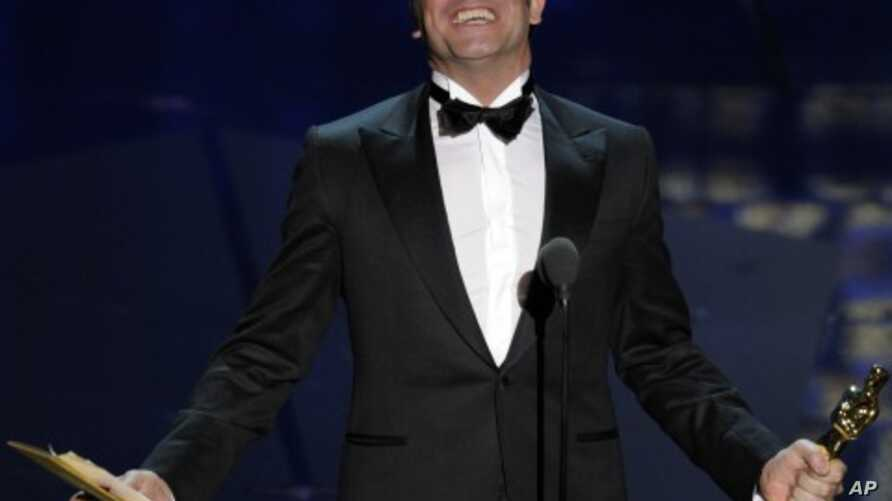 """Jean Dujardin accepts the Oscar for best actor in a leading role for """"The Artist"""" during the 84th Academy Awards on Feb. 26, 2012, in Hollywood."""