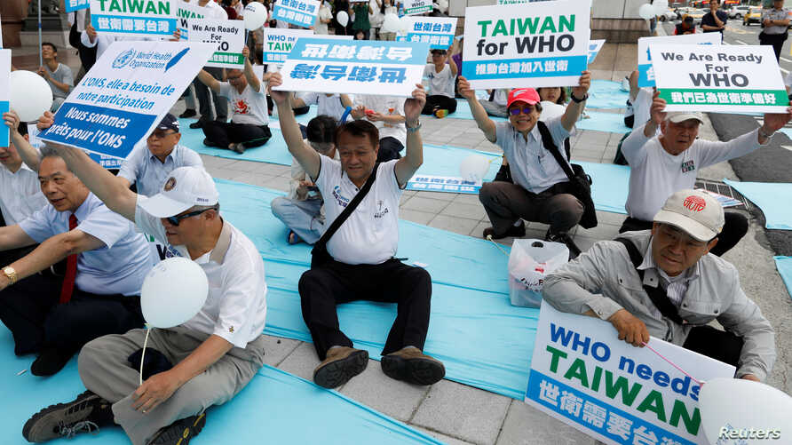 FILE - Protesters take part in a rally in Taipei against Taiwan being excluded from U.N.'s annual World Health Assembly (WHA) in Geneva, Taiwan, May 21, 2017.