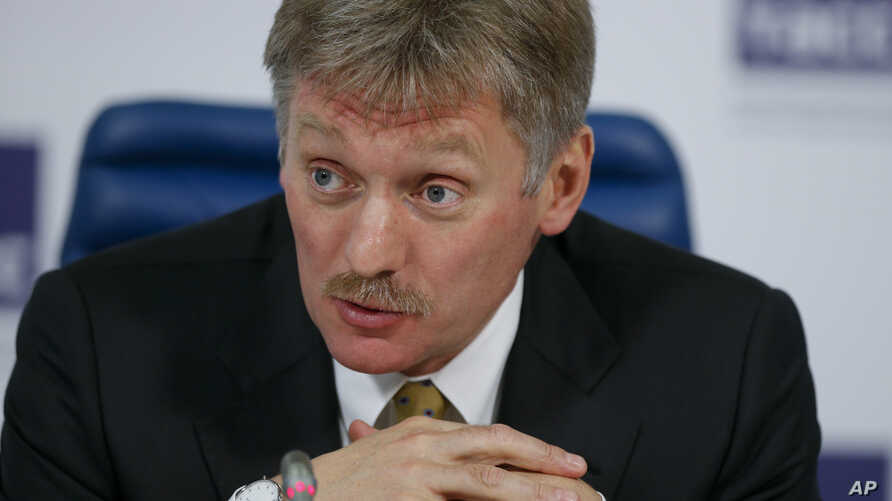 FILE - Russian President Vladimir Putin's press secretary Dmitry Peskova speaks at a round table to mark President Vladimir Putin's 15 years in office, in Moscow,  March 31, 2015.