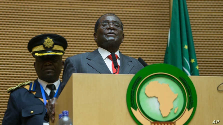 FILE - Zimbabwe president Robert Mugabe delivers a speech during the opening ceremony of the 26 ordinary of the African Union Summit in Ethiopian capital Addis Ababa, Jan. 30, 2016.