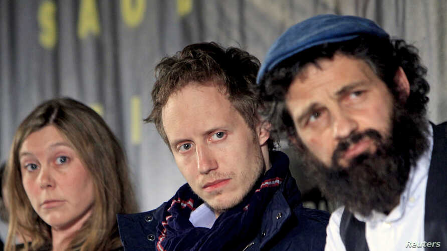"""Scriptwriter Clara Royer (L-R), director Laszlo Nemes and lead actor Geza Rohrig attend a news conference for the film """"Son of Saul"""" in Budapest, Hungary, May 28, 2015."""