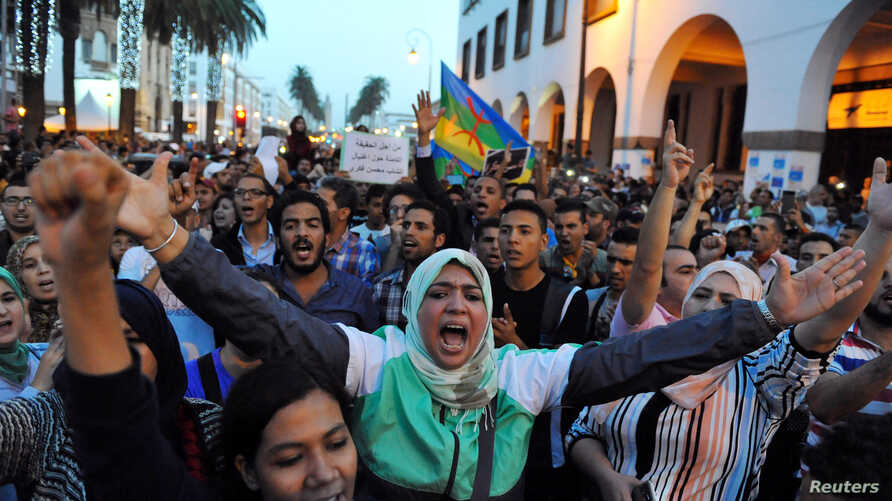Protests take part in a rally, October 30, 2016, in Rabat, Morocco, after a fishmonger was crushed to death inside a garbage truck as he tried to retrieve fish confiscated by police.