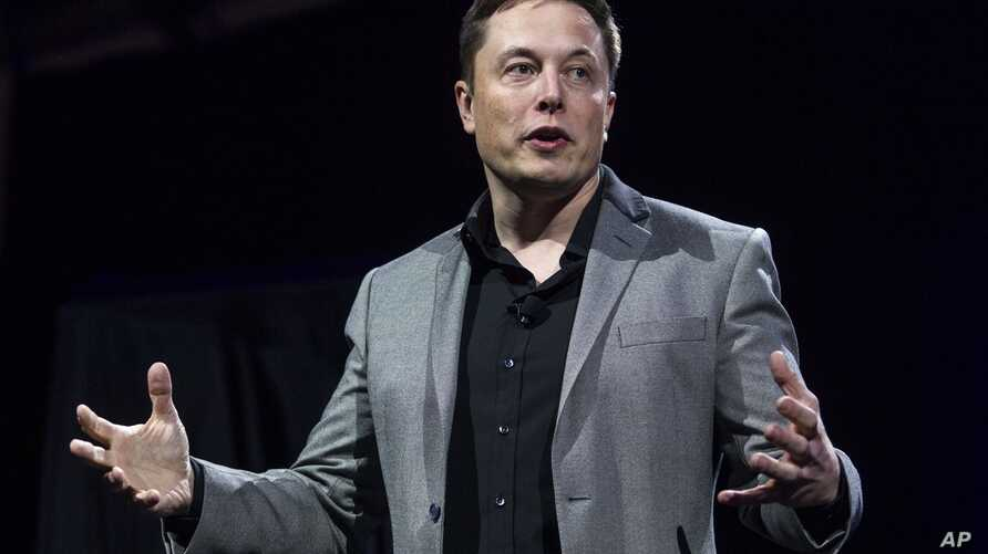 FILE - Tesla Motors CEO Elon Musk unveils the company's newest products, in Hawthorne, Calif., April 30, 2015.  Tesla Motors and SolarCity are going to sell solar roof tiles that are customizable and meant to look like a traditional roof.