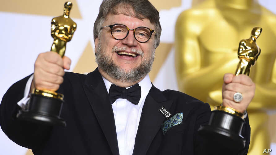 "Guillermo del Toro, winner of the awards for best director and best picture for ""The Shape of Water,"" poses in the press room at the Oscars, March 4, 2018, at the Dolby Theatre in Los Angeles."
