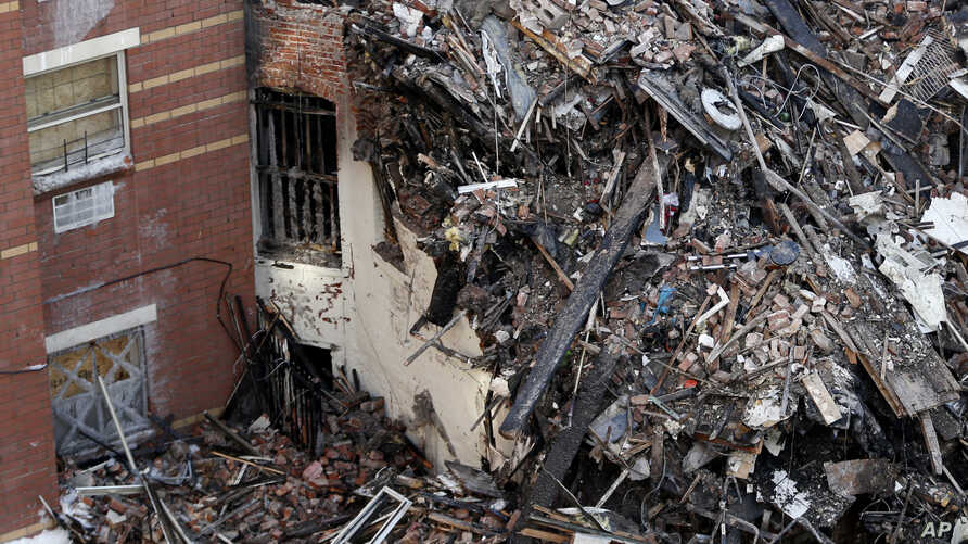Rubble is seen Friday, March 14, 2014, two days after a natural gas explosion leveled two apartment buildings in New York.