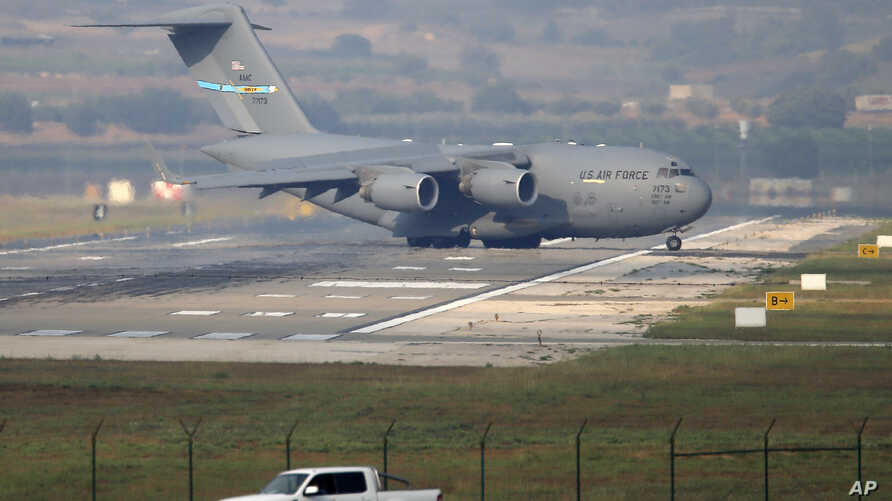 A United States Air Force cargo plane maneuvers on the runway after it landed at the Incirlik Air Base, on the outskirts of the city of Adana, southern Turkey, July 31, 2015.