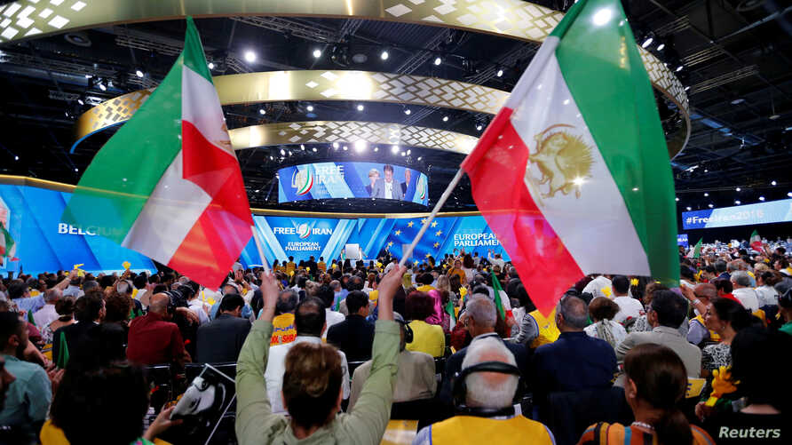 FILE - Supporters of Maryam Rajavi, president-elect of the National Council of Resistance of Iran (NCRI), attend a rally in Villepinte, near Paris, France, June 30, 2018.