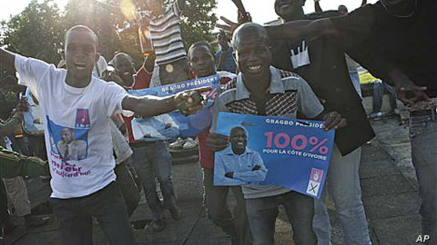 Supporters of Laurent Gbagbo celebrate in the streets of Adjame neighborhood, in Abidjan, Ivory Coast, after the constitutional council declared incumbent Gbagbo the winner a day after the election chief handed victory to the opposition, Dec 3, 2010