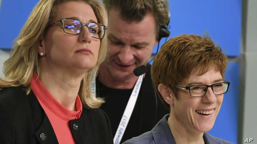 Christian Democratic top candidate Saarland governor Annegret Kramp-Karrenbauer, right, and the top candidate of the Social Democratic party Anke Rehlinger attend a TV debate after the state election in German state of Saarland in Saarbruecken, March