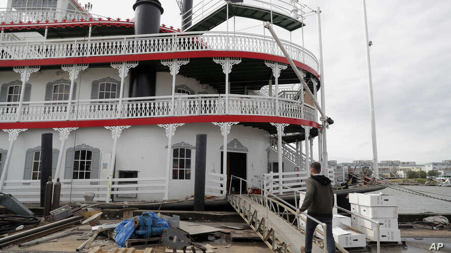 In this Nov. 29, 2018, photo, Matt Dow, project manager for the restoration of the City of New Orleans riverboat, walks on the vessel in New Orleans. The paddlewheel riverboat will soon be taking tourists on excursions around the New Orleans area.