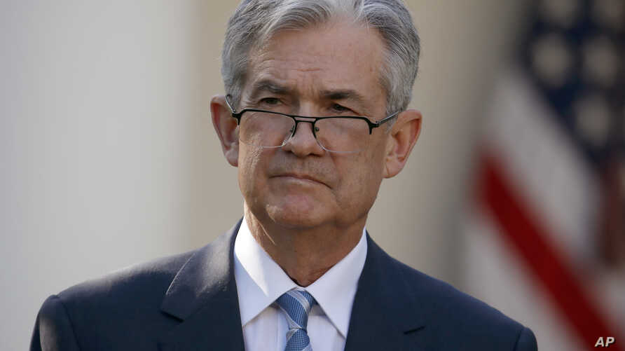 Federal Reserve board member Jerome Powell stands as President Donald Trump announces him as his nominee for the next chair of the Federal Reserve in the Rose Garden of the White House in Washington, Nov. 2, 2017.