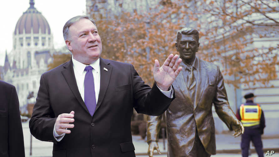 US Secretary of State, Mike Pompeo, is pictured next to a scuplture of former US President Ronald Reagan at the Liberty square (Szabadsag) in Budapest, Hungary, Feb. 11, 2019.