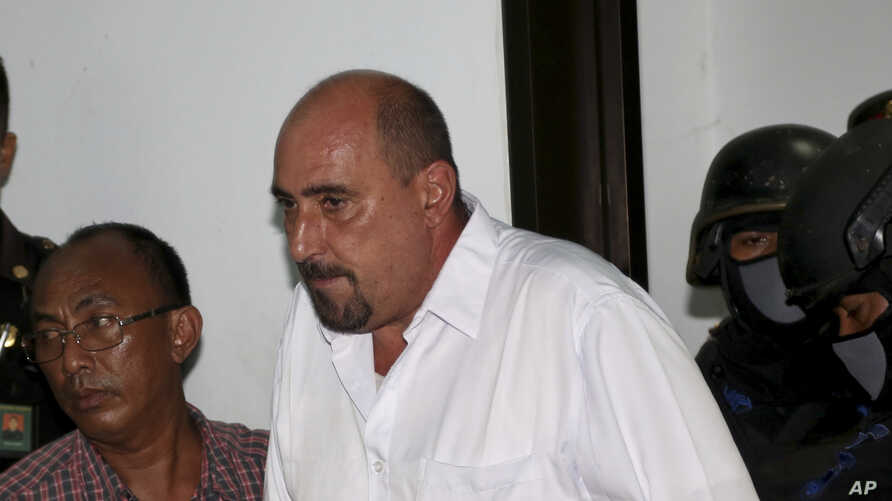 FILE - Serge Atlaoui, a French national who is on death row after being convicted of drug offences, enters the courtroom for his judicial review hearing at the district court in Tangerang, Indonesia, April 1, 2015.