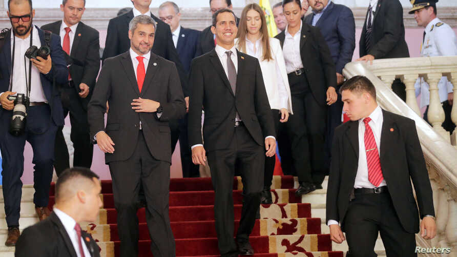 Venezuela's opposition leader Juan Guaido, whom many nations have recognized as the country's rightful interim ruler, and Paraguay's President Mario Abdo Benitez look on after a meeting at the Lopez Palace in Asuncion, Paraguay, March 1, 2019.