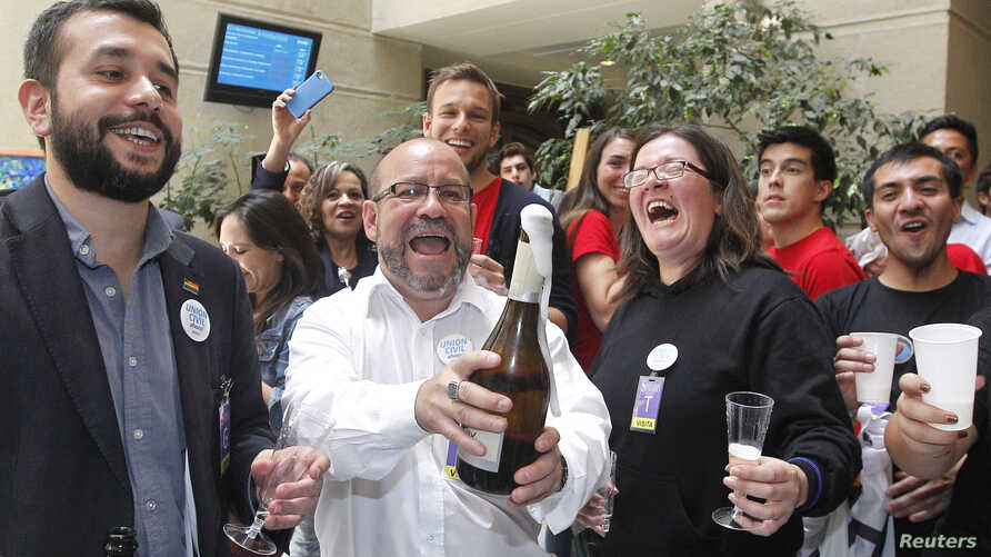 LGBT activist group Motion of Integration and Gay Liberation (MOVILH) leader Rolando Jimenez celebrates with group members after the Chilean Congress passed a bill recognizing civil unions in Valparaiso, Chile, Jan. 28, 2015.