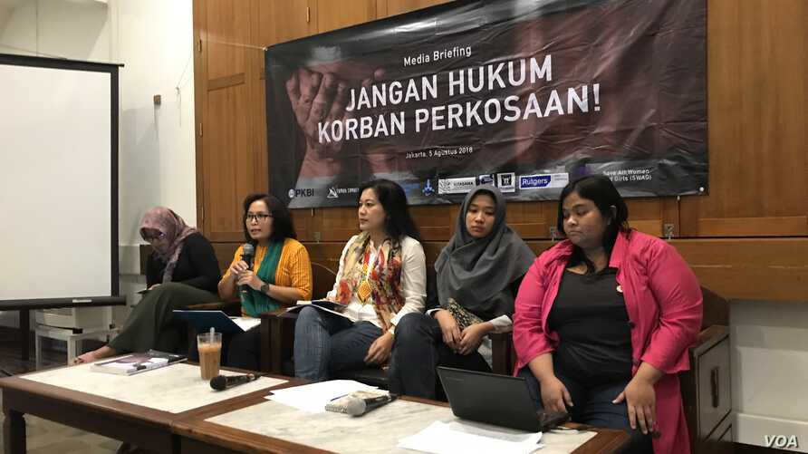 Members of the Justice Alliance for Rape Victims appear at a joint press conference in Jakarta, Indonesia on August 5, 2018.
