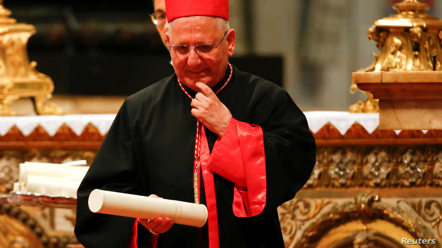 FILE - Cardinal Louis Raphael I Sako of Iraq is seen during a consistory ceremony to install 14 new cardinals in Saint Peter's Basilica at the Vatican, June 28, 2018.
