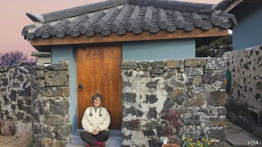 "Brenda Paik Sunoo, 70, relocated to Jeju in 2015. She and her husband built an house there and this month she published ""a love letter to Jeju,"" ""Stone House on Jeju Island: Improvising Life Under a Healing Moon."""