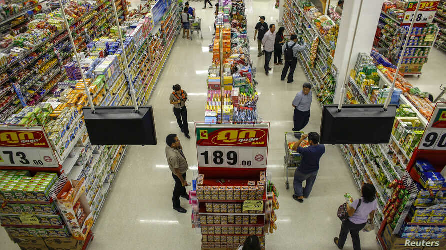 FILE - People shop in a supermarket inside a department store in Bangkok.