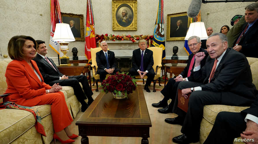 U.S. President Donald Trump and Vice President Mike Pence meet with House Democratic leader Nancy Pelosi, House Speaker Paul Ryan, Senate Majority Leader Mitch McConnell and Senate Minority Leader Chuck Schumer in the Oval Office of the White House i