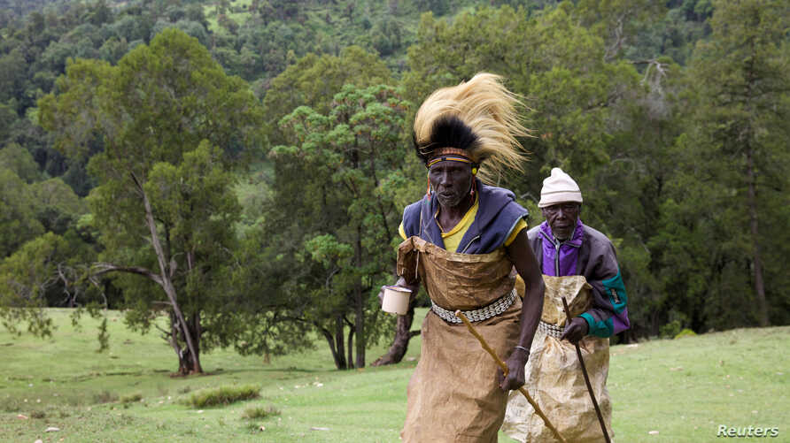 FILE - Kenyan men from the Sengwer community protest over their eviction from their ancestral lands, Embobut Forest, by the government for forest conservation in western Kenya, April 19, 2016.