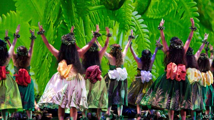 Dancers wear traditional dress in Hula for the Goddess.