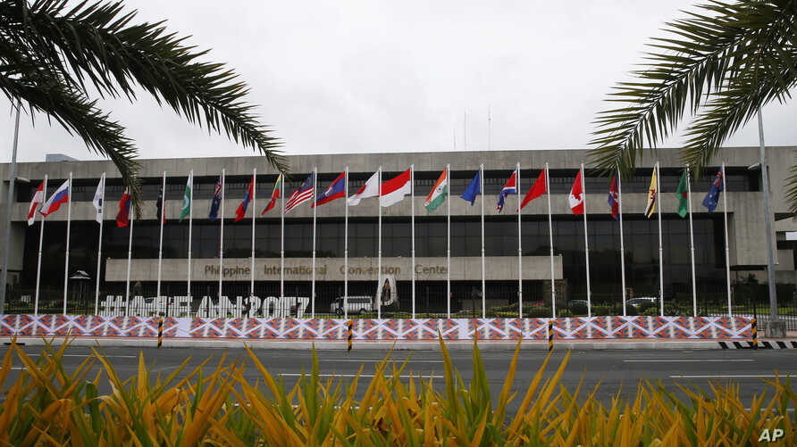 Flags flutter outside the Philippine International Convention Center, the venue for the 50th Association of Southeast Asian Nations Foreign Ministers' Meeting and its regional partners, Aug. 2, 2017 in suburban Pasay city, Philippines.