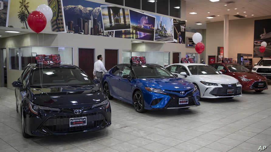 FILE - Toyota sedans are displayed in a showroom at Puente Hills Toyota in Industry, Calif., Feb. 14, 2019.