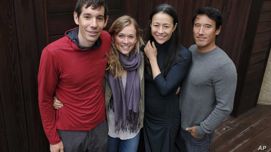 "FILE - Alex Honnold, from left, and Sanni McCandless, subjects of the documentary film ""Free Solo,"" pose with co-directors Elizabeth Chai Vasarhelyi and Jimmy Chin at the InterContinental Hotel during the Toronto International Film Festival in Toront"