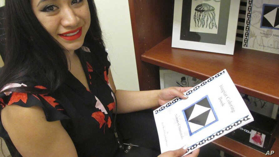Britt'Nee Brower shows an Inupiat coloring book she published and she talks about the new Inupiat Eskimo language option now available for Facebook bookmarks, action buttons. Alaskans made the option a reality through the social media giant's communi