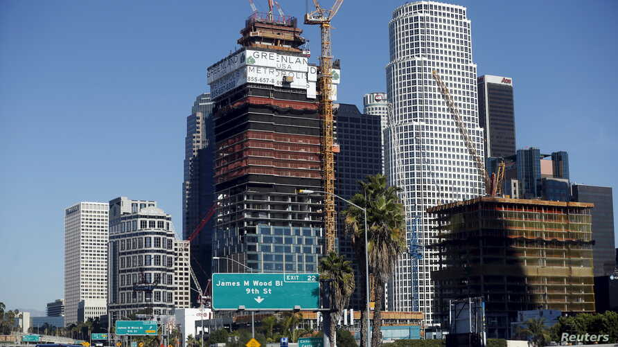 FILE - The new Metropolis project, which is being built by Chinese developer Greenland, is seen in downtown Los Angeles from the 110 freeway in Los Angeles, California, United States, Nov. 12, 2015.