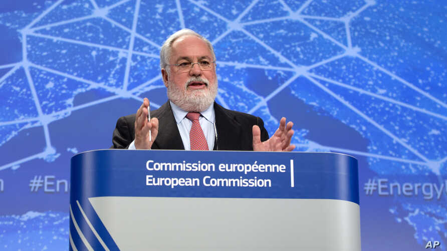 FILE - European Commissioner for Climate Action and Energy Miguel Arias Canete speaks during a media conference at EU headquarters in Brussels Feb. 25, 2015.