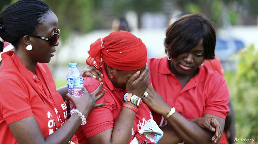 """#Bring Back Our Girls"" campaigners console a fellow member who broke down in tears, as more towns in Nigeria come under attack from Boko Haram in Abuja, Nov. 3, 2014."