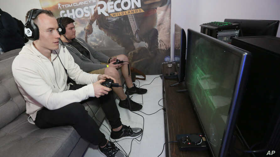 Two players enjoy some quality time  with a video game - Tom Clancy's Ghost Recon Wildlands: War Within the Cartel - during a livestream event on Feb. 16, 2017, in Los Angeles.