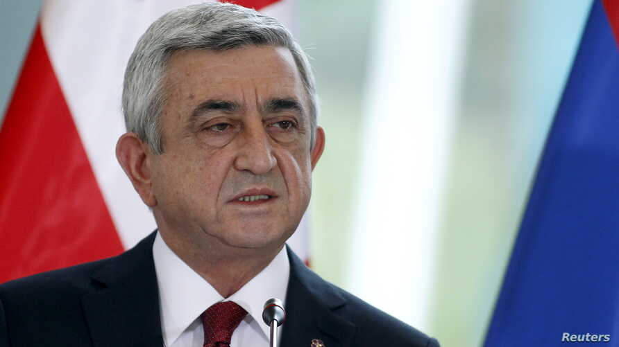 The Armenian opposition says the changes voted on in Sunday's referendum are a ruse to let President Serzh Sarksyan, pictured in October in Tbilisi, Georgia, take on an enhanced prime ministerial role at the head of the Republican Party after his pre