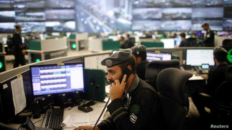 Saudi security guards monitor screens at the National Center for Security Operations in the holy city of Mecca, Saudi Arabia, Aug. 29, 2017.